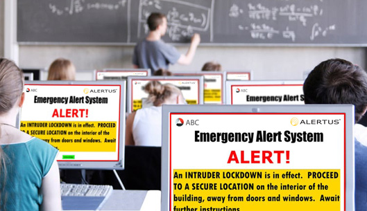 Emergency Alert System graphic on computer screens